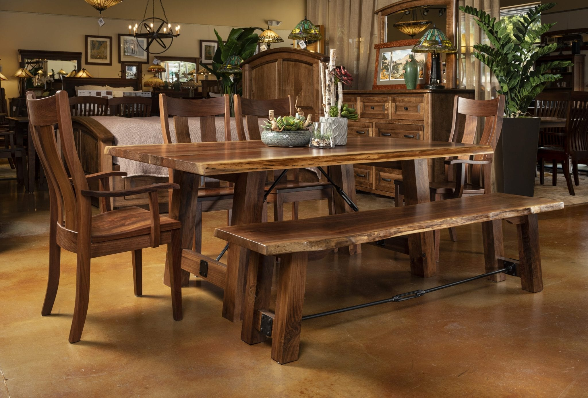Dining room table, chairs, and bench with a live edge finish